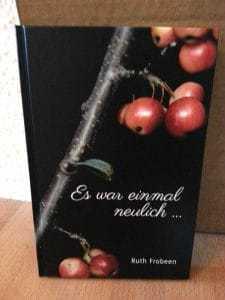 Foto des Buchcovers mit einem Zwei mit Äpfeln Märchenbuch Ruth Frobeen